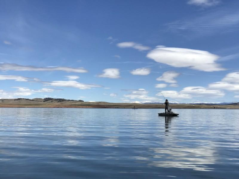 A man paddleboats on the Antero Reservoir