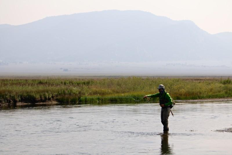 Fly fisherman on a plains river