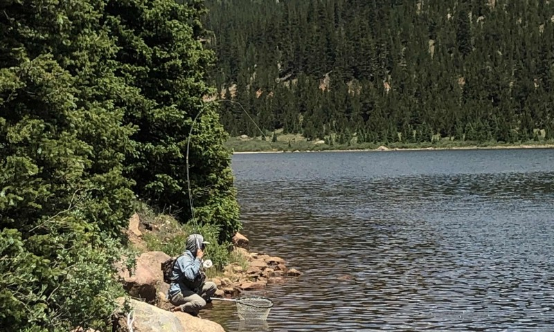 Angel Cruz working a high altitude lake somewhere in Colorado.